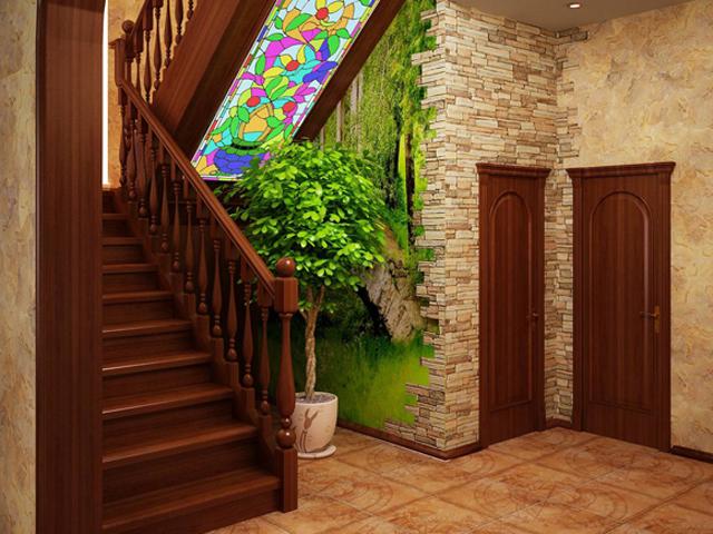 Варианты обустройства пространства под лестницей